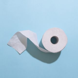 Toilet roll on blue background