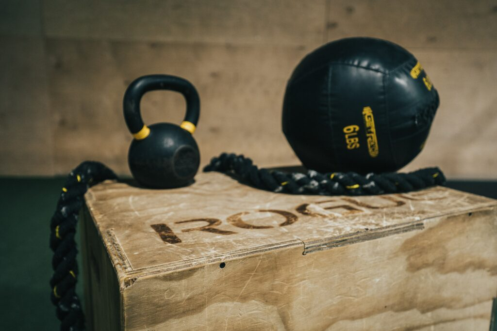 dumbells and medicine ball on box